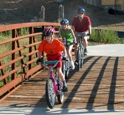 Bicyclists crossing bridge