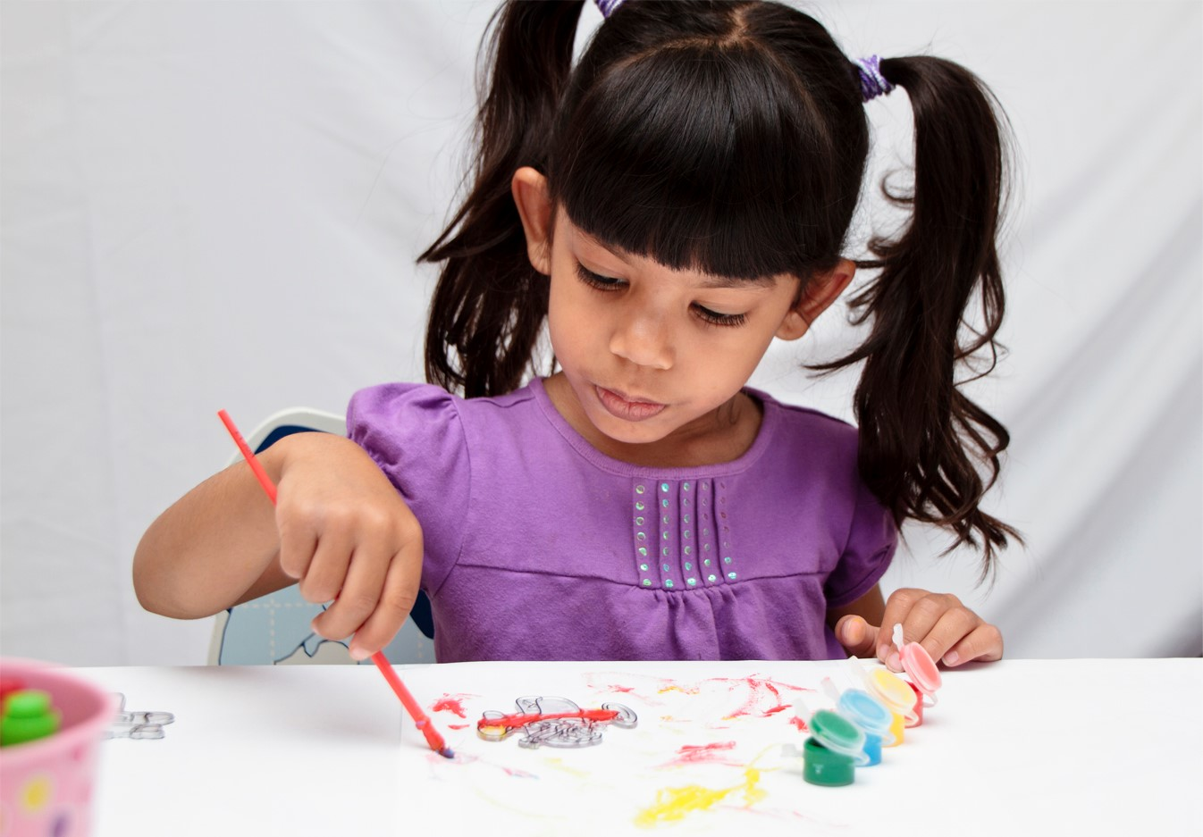 preschool_girl_painting_small.jpg