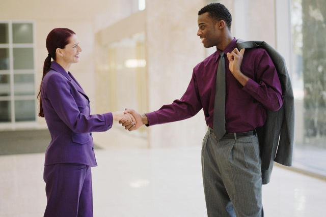 two_business_people_shaking_hands_200021941-001
