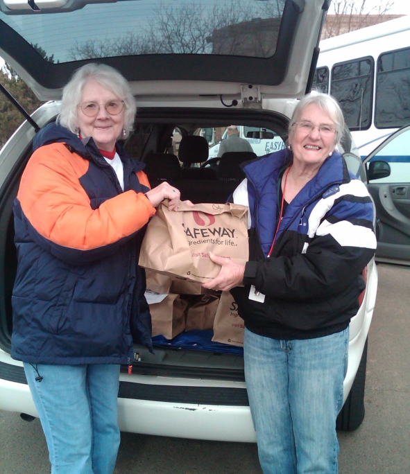Senior Center patrons and volunteers Eileen Niehoff and Wanda Watson deliver Blizzard Bags to the Broomfield seniors.